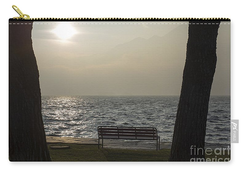 Bench Carry-all Pouch featuring the photograph Bench On A Foggy Lake Front by Mats Silvan