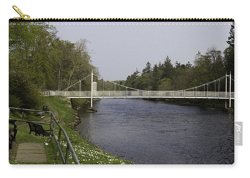 Bench Carry-all Pouch featuring the photograph Benches And Suspension Bridge Over River Ness by Ashish Agarwal