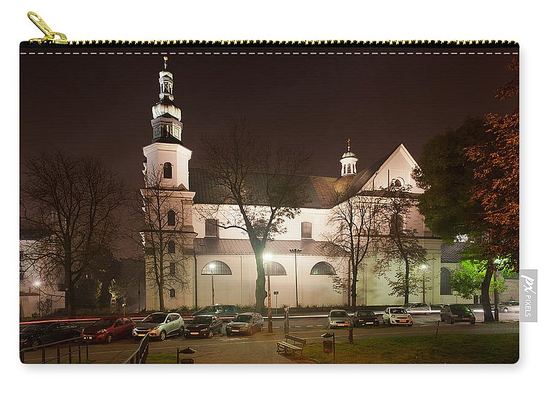 Krakow Carry-all Pouch featuring the photograph Bernandine Church At Night In Krakow by Artur Bogacki