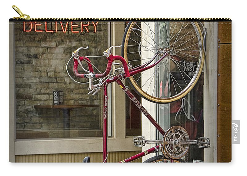 Digital Carry-all Pouch featuring the photograph Bicycle Attached To Wall Outside Of Fast Food Restaurant by Randall Nyhof
