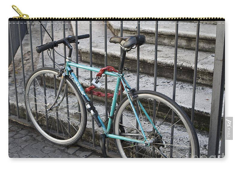 Travel Carry-all Pouch featuring the photograph Bicycle Is Chained To A Fence by Jason O Watson