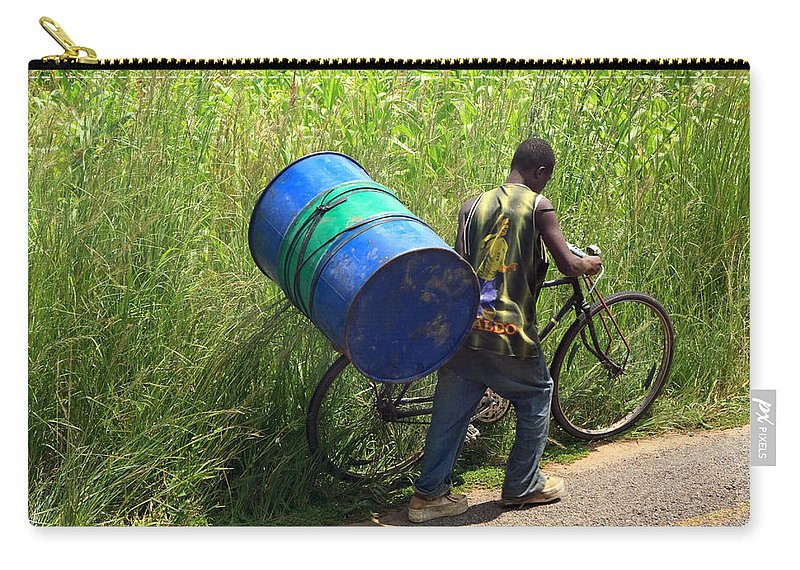Africa Carry-all Pouch featuring the photograph Bicycle Strain by Aidan Moran
