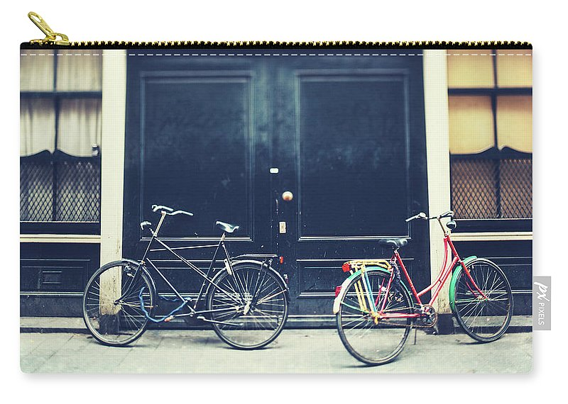 Black Color Carry-all Pouch featuring the photograph Bicycles In Amsterdam by Moreiso