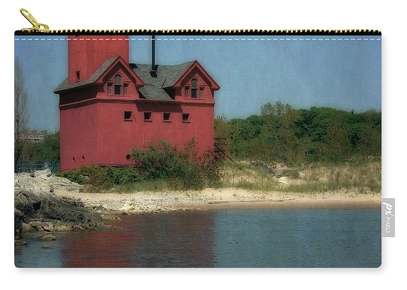 Michigan Carry-all Pouch featuring the photograph Big Red Holland Michigan Lighthouse by Michelle Calkins