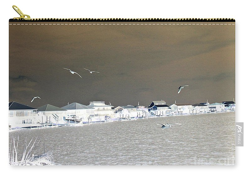 Birds In Flight Carry-all Pouch featuring the photograph Birds In Flight Over Lafitte Bay by Marian Bell