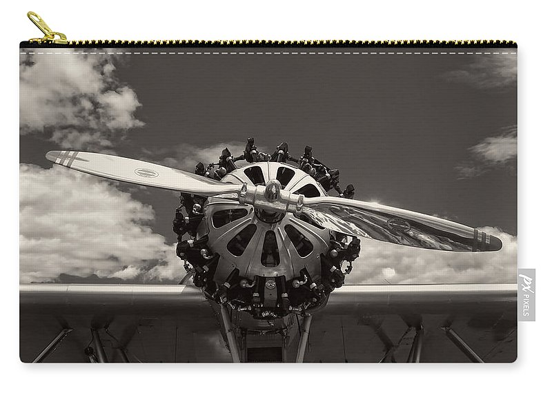 Airplane Carry-all Pouch featuring the photograph Black And White Close-up Of Airplane Engine by Keith Webber Jr