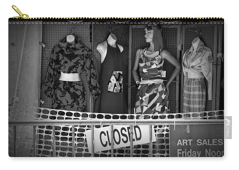 Casual Clothing Carry-all Pouch featuring the photograph Black And White Outdoor Clothing Display by Randall Nyhof