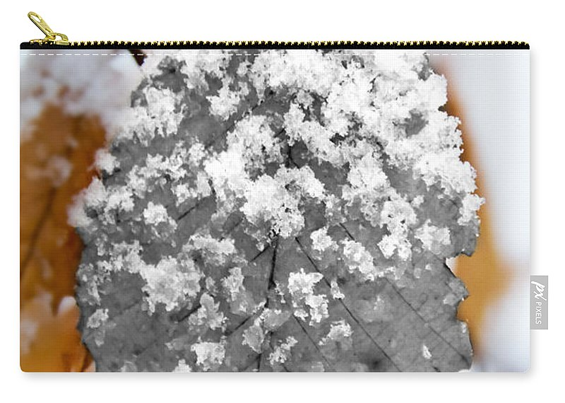 Black And White Snow Leaf Carry-all Pouch featuring the photograph Black And White Snow Leaf by Jemmy Archer