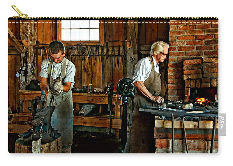 Blacksmith Carry-all Pouch featuring the photograph Blacksmith And Apprentice by Steve Harrington