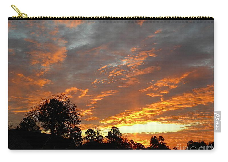 Christmas Carry-all Pouch featuring the photograph Blazing Christmas Sunset by Matthew Seufer