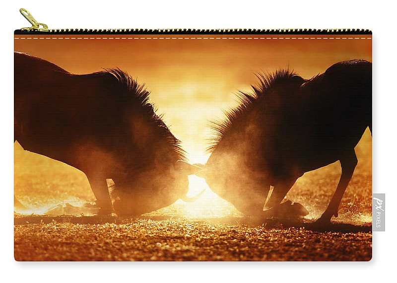 Wildebeest Carry-all Pouch featuring the photograph Blue Wildebeest Dual In Dust by Johan Swanepoel