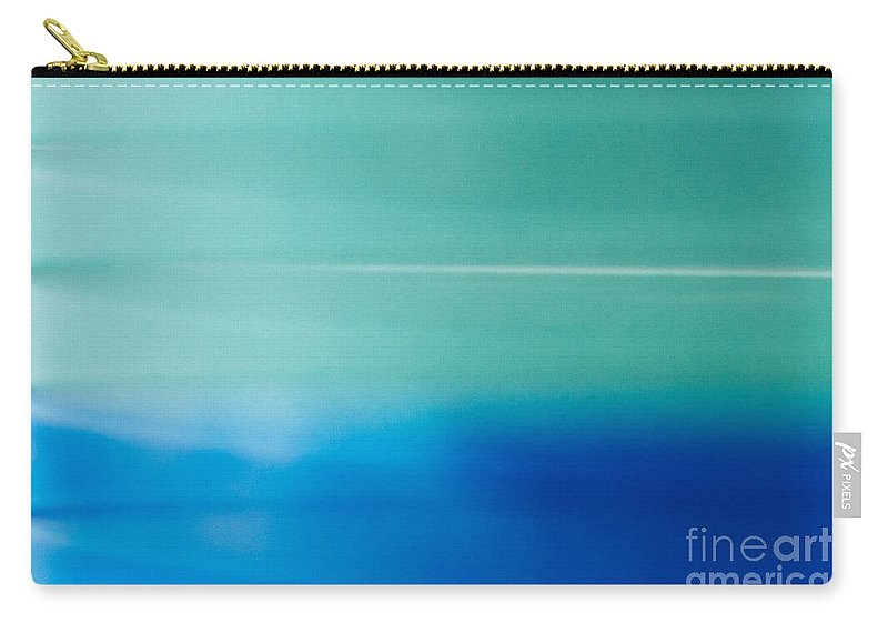 100mm Carry-all Pouch featuring the photograph Blur Of The Bet by Kyra Savolainen