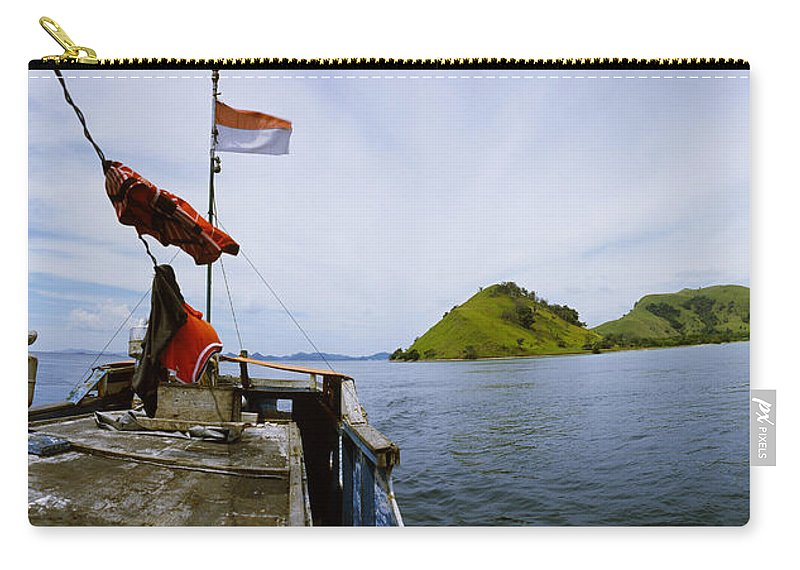 Photography Carry-all Pouch featuring the photograph Boat In The Sea With Islands by Panoramic Images