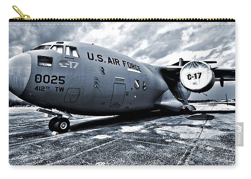 Boeing C-17 Airplane Carry-all Pouch featuring the photograph Boeing C-17 Airplane by Dan Sproul