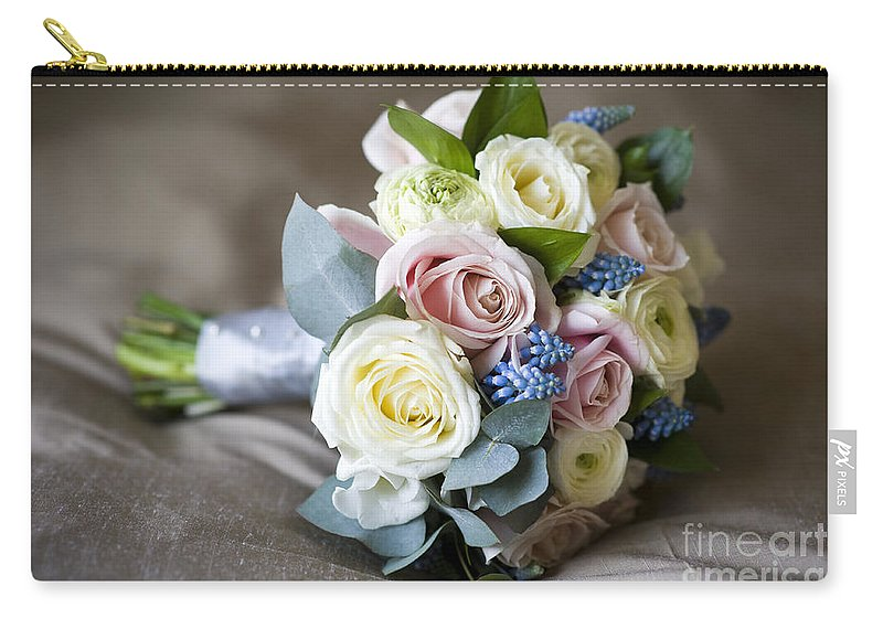 Bouquet Carry-all Pouch featuring the photograph Bouquet Of Spring Flowers by Lee Avison