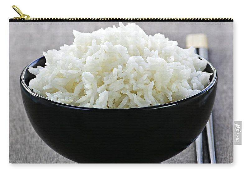 Rice Carry-all Pouch featuring the photograph Bowl Of Rice With Chopsticks by Elena Elisseeva