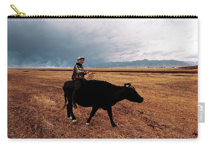 Scenics Carry-all Pouch featuring the photograph Boy Sitting Cow In Field by Touch The Word By Heart.