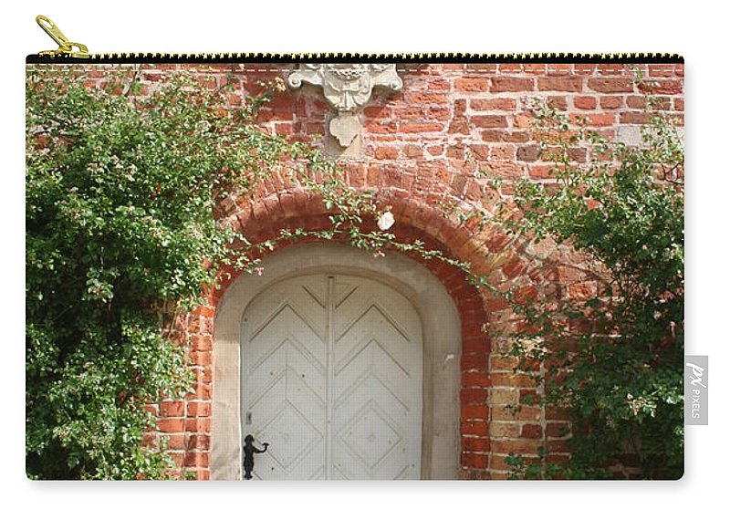 Brick Carry-all Pouch featuring the photograph Brickcastle And White Door by Christiane Schulze Art And Photography