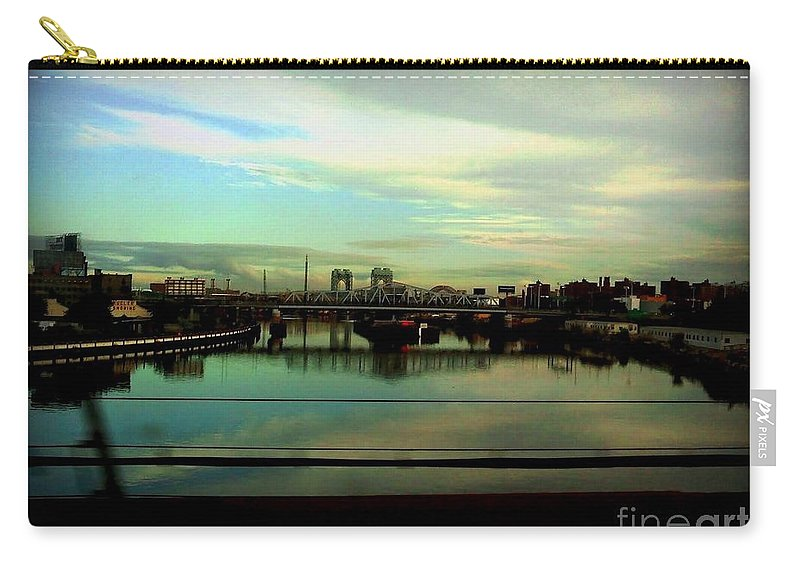 New York Carry-all Pouch featuring the photograph Bridge With White Clouds by Miriam Danar