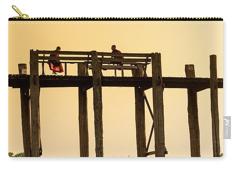 Grass Carry-all Pouch featuring the photograph Buddhist Monks Seated On U Bein Bridge by Merten Snijders