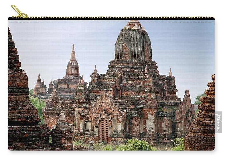 Tranquility Carry-all Pouch featuring the photograph Buddhist Monks Walking Past Temple by Martin Puddy