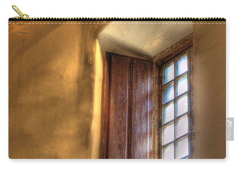 Mission San Diego De Alcala Carry-all Pouch featuring the photograph By The Light Of The Window by Bob Christopher