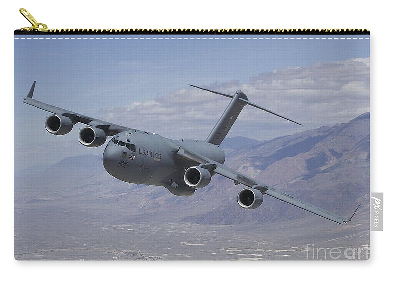 The C-17 Globemaster Iii T-1 Flies Over Owens Valley Carry-all Pouch featuring the photograph C-17 Globemaster IIi by Paul Fearn