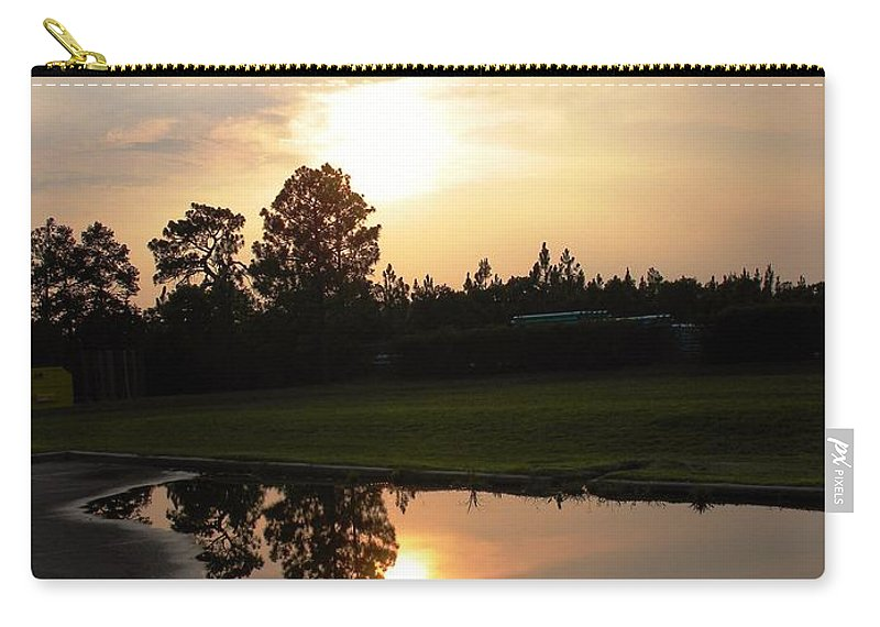 Sunset Carry-all Pouch featuring the photograph Calm After The Storm by Matthew Seufer