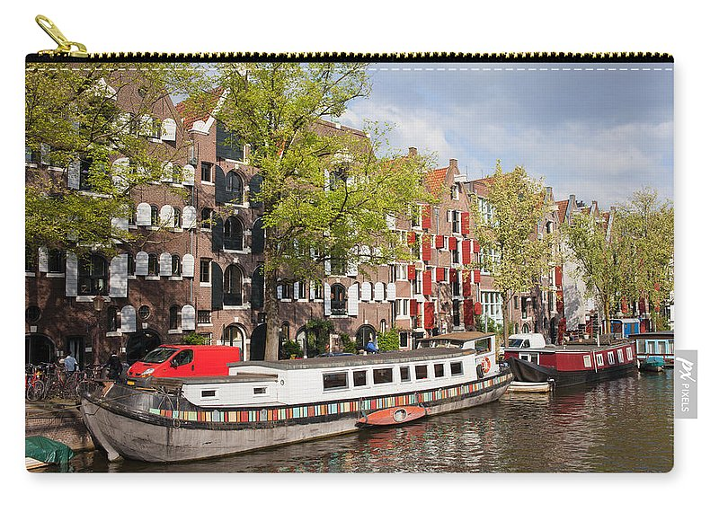 Amsterdam Carry-all Pouch featuring the photograph Canal In Amsterdam by Artur Bogacki