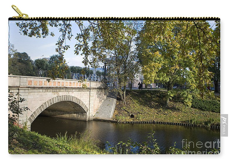 Travel Carry-all Pouch featuring the photograph Canal Near Freedom Monument Riga by Jason O Watson