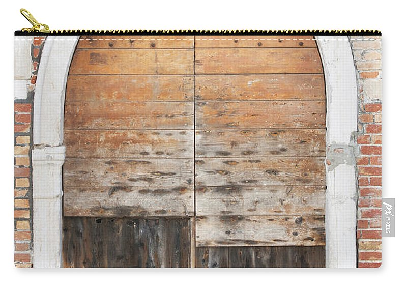 Vertical Carry-all Pouch featuring the photograph Canalside Weathered Door Venice Italy by Sally Rockefeller
