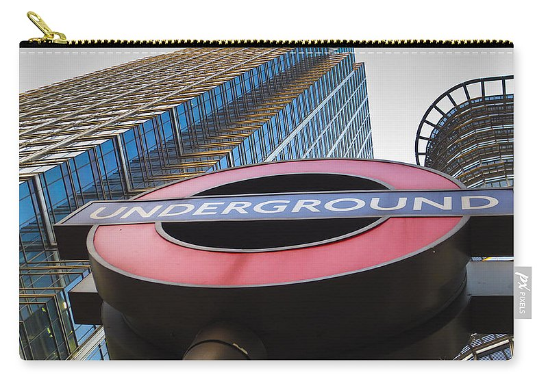 Tube Carry-all Pouch featuring the photograph Canary Wharf Tube Sign by David Pyatt