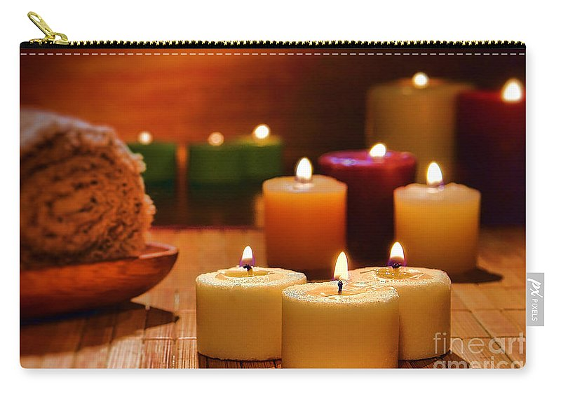 Candles Carry-all Pouch featuring the photograph Candles Burning In A Spa by Olivier Le Queinec