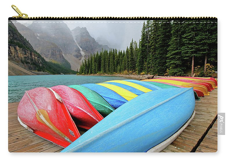 Scenics Carry-all Pouch featuring the photograph Canoes Line Dock At Moraine Lake, Banff by Wildroze