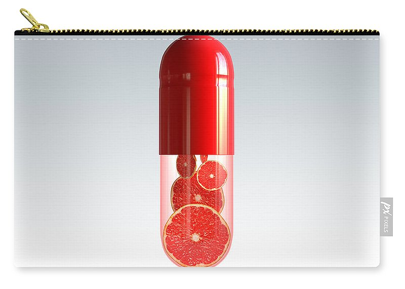 Capsule Carry-all Pouch featuring the photograph Capsule With Citrus Fruit by Johan Swanepoel
