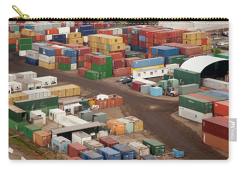 Freight Transportation Carry-all Pouch featuring the photograph Cargo Containers In A Freight Yard by Tobias Titz