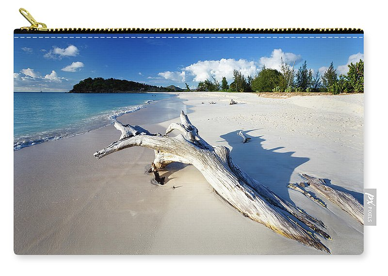 Water's Edge Carry-all Pouch featuring the photograph Caribbean Beach With Driftwood by Michaelutech