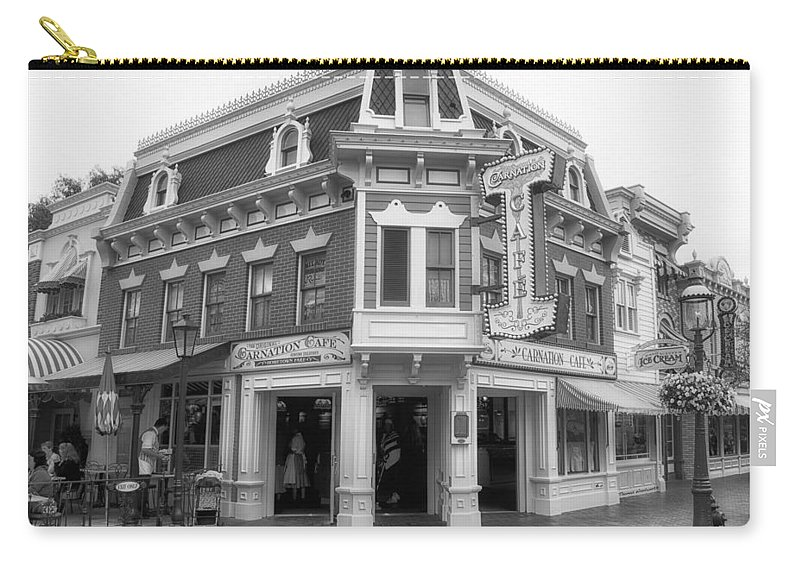 Disney Carry-all Pouch featuring the photograph Carnation Cafe Main Street Disneyland Bw by Thomas Woolworth