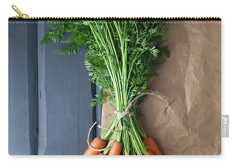 Bunch Carry-all Pouch featuring the photograph Carrots With Brown Paper On Wooden by Westend61