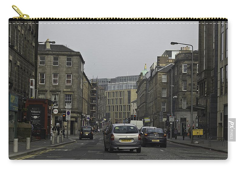 Action Carry-all Pouch featuring the photograph Cars And Buildings On The Streets Of Edinburgh by Ashish Agarwal