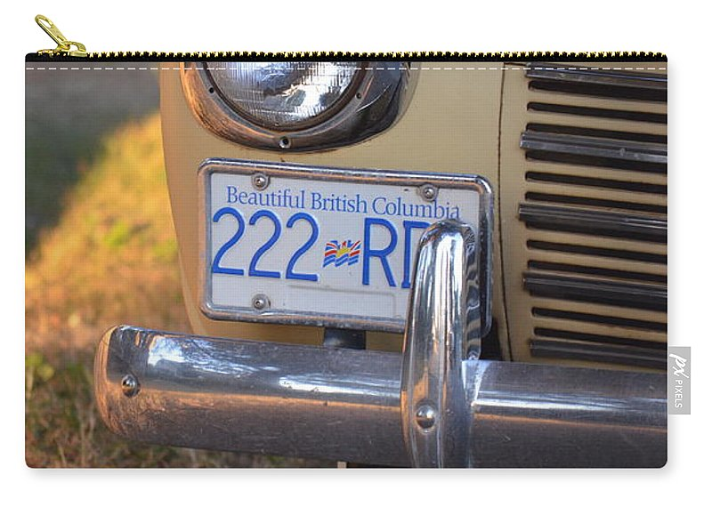 Car Carry-all Pouch featuring the photograph Catch Twenty Two by The Artist Project