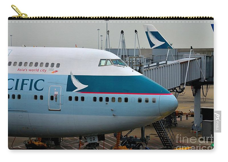 Cathay Pacific Carry-all Pouch featuring the photograph Cathay Pacific 747 Jumbo Jet Parked At Hong Kong Airport by Imran Ahmed