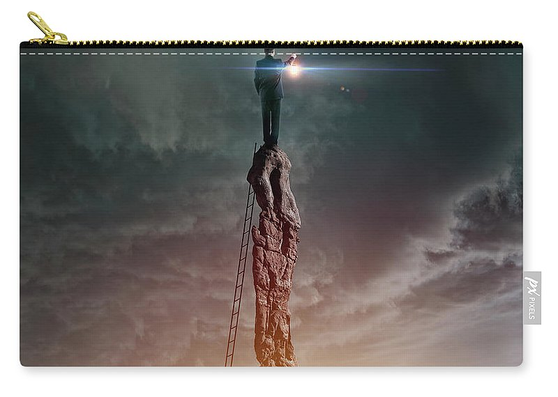 Corporate Business Carry-all Pouch featuring the photograph Caucasian Man With Lantern On Rocky by Colin Anderson Productions Pty Ltd