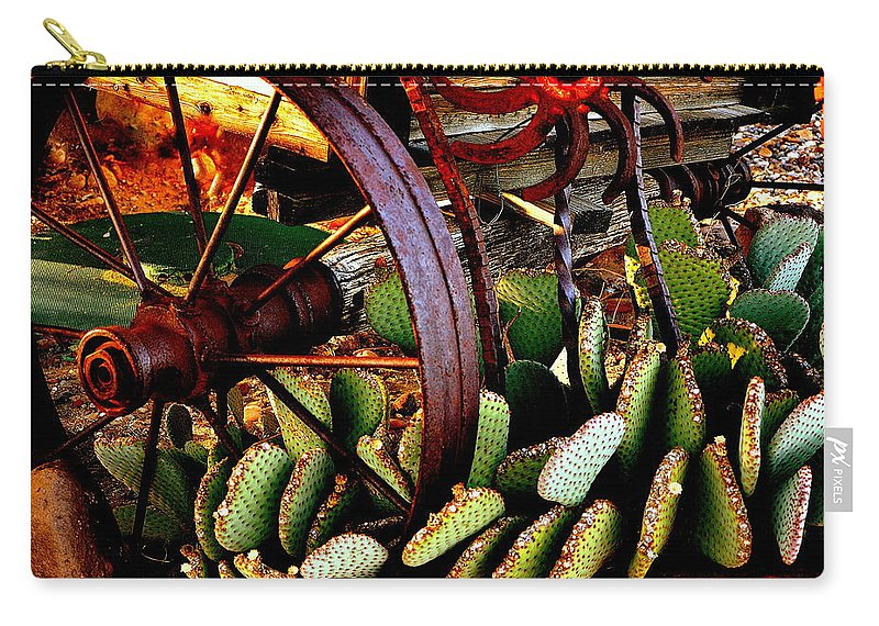 Wagon Wheel Carry-all Pouch featuring the photograph Caught In A Cactus Patch-sold by Antonia Citrino
