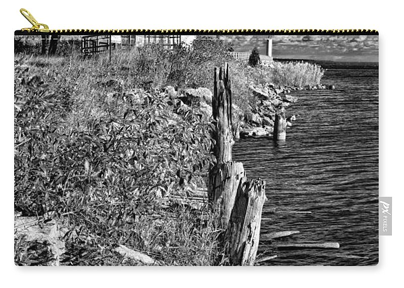 Michigan Carry-all Pouch featuring the photograph Cheboygan Lighthouse Bw by Timothy Hacker