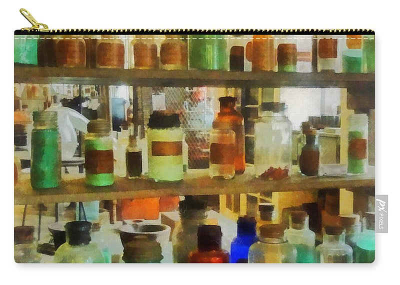 Science Carry-all Pouch featuring the photograph Chemistry - Bottles Of Chemicals Green And Brown by Susan Savad