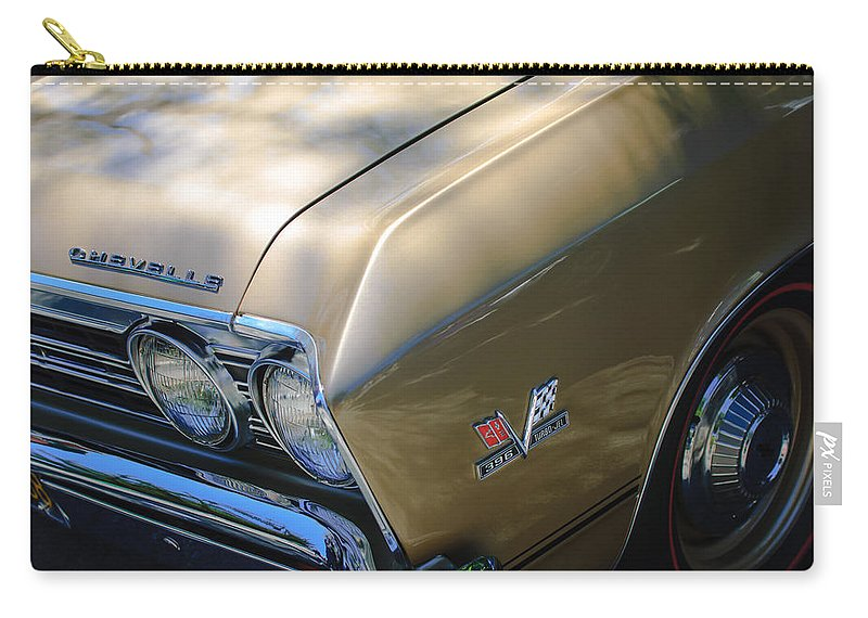 Chevrolet Chevelle Ss Headlight Emblems Carry-all Pouch featuring the photograph Chevrolet Chevelle Ss Headlight Emblems by Jill Reger