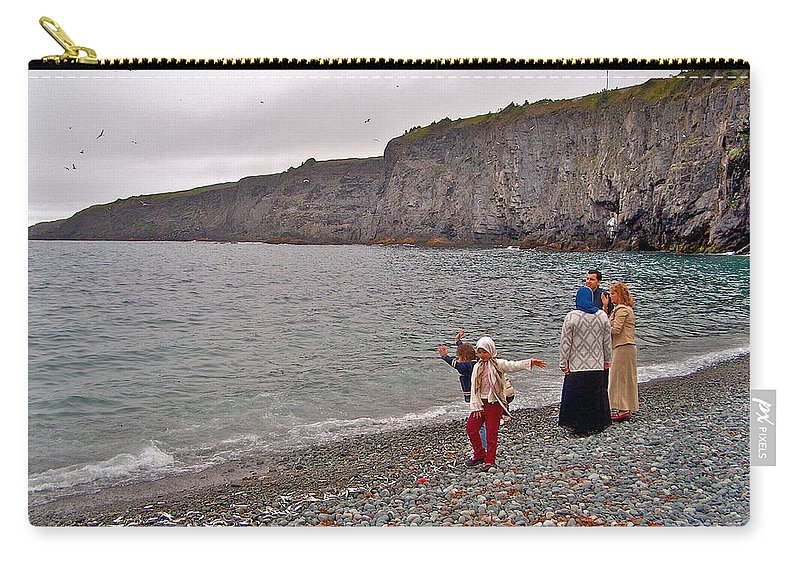 Children Throwing Capelin Back Into The Ocean At Middle Cove Carry-all Pouch featuring the photograph Children Throwing Capelin Back Into The Ocean At Middle Cove-nl by Ruth Hager