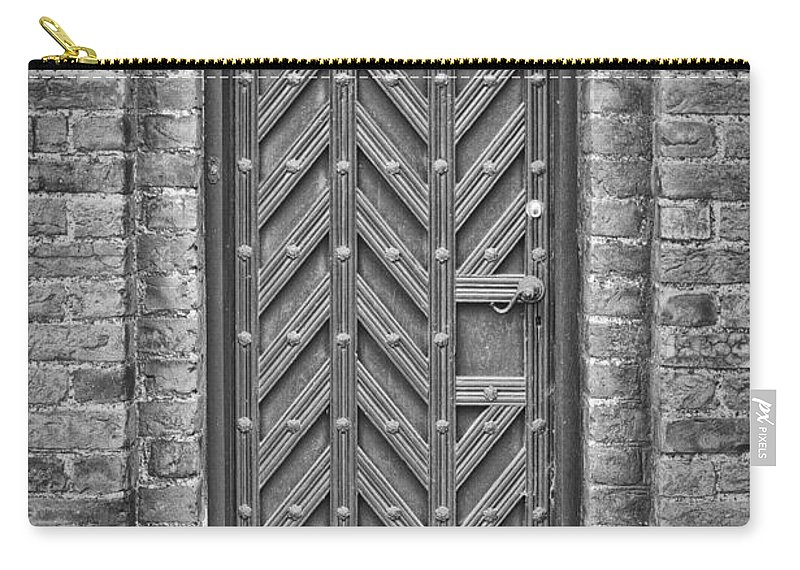 Monochromatic Carry-all Pouch featuring the photograph Church Door 02 by Antony McAulay