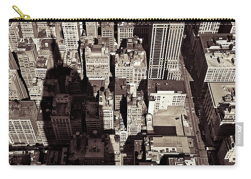 New York Carry-all Pouch featuring the photograph City Shadow by Dave Bowman